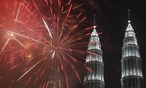 Fireworks explode in front of Malaysia's landmark building, Petronas Twin Towers, during the New Year's Eve celebration in Kuala Lumpur, Malaysia, Friday, Jan. 1, 2016. (AP Photo/Joshua Paul)